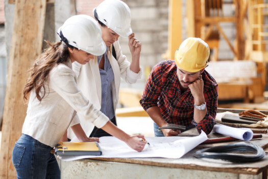 Two,Female,Inspectors,And,Architects,Discuss,With,Head,Engineer,About
