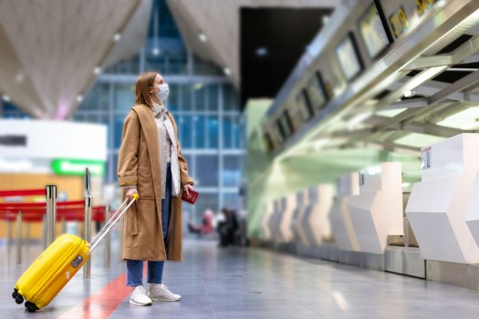 Woman,With,Luggage,Stands,At,Almost,Empty,Check-in,Counters,At