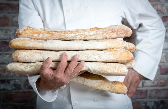 A,Baker,Holding,Traditional,Bread,French,Baguettes