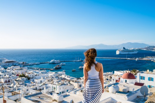 Female,Tourist,Looking,At,Mykonos,Town,,Greece
