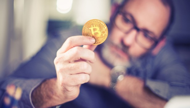 Bitcoins,-,Bitcoin,In,Hand,Of,A,Casual,Businessman,Wondering