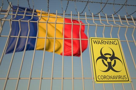 Coronavirus,Warning,Sign,On,The,Fence,On,The,Romanian,Flag