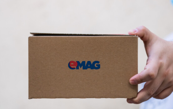 Deliveryman,Holding,Emag,Cardboard,Box,Isolated,On,Blurred,Background,In