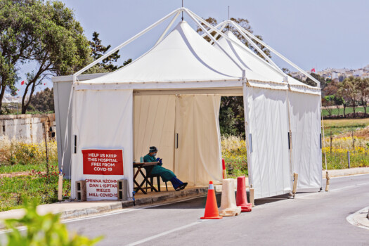 Nurse,Sits,In,Temporary,Pavilion,For,Control,Coronavirus,At,Entrance
