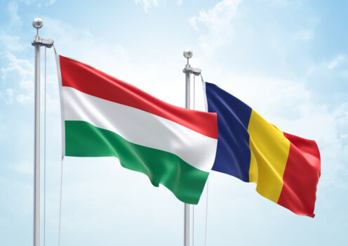 3d,Rendering,Of,Hungary,&,Romania,Flags,Are,Waving,In