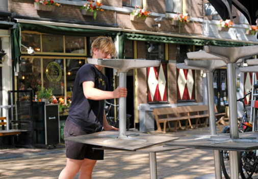Beestenmarkt,,Delft,,Netherlands.,May,8,,2020.,Guy,Lifting,Tables,Outside