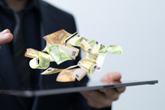 Euro,Bills,Flying,Around,In,Hand