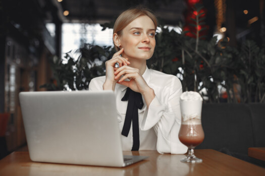businesswoman-sitting-table-with-laptop