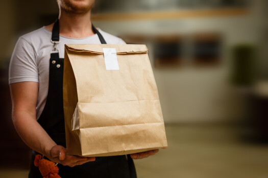 Diverse,Of,Paper,Containers,For,Takeaway,Food.,Delivery,Man,Is