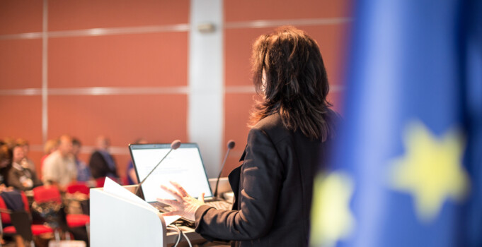 Female,Speaker,Giving,A,Talk,On,Corporate,Business,Conference.,Audience