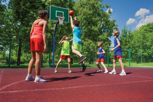 Team,In,Colorful,Uniforms,Playing,Basketball,Game