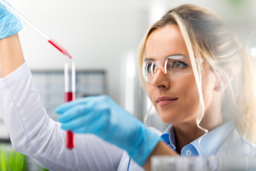 Young,Attractive,Female,Scientist,In,Protective,Glasses,And,Gloves,Dropping
