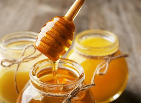 Pouring,Aromatic,Honey,Into,Jar,,Closeup